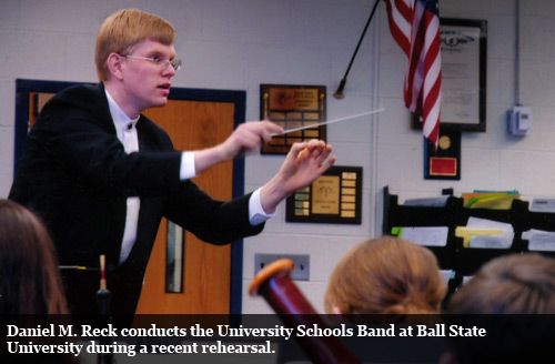 Daniel M. Reck conducts the University Schools Band